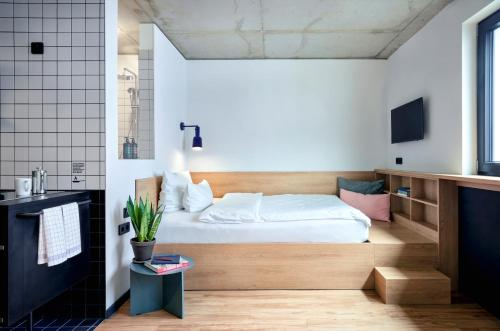 A bed or beds in a room at STAYERY Apartments Friedrichshain