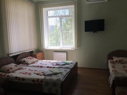 Кровать или кровати в номере Гостевой дом на Санаторной 2А