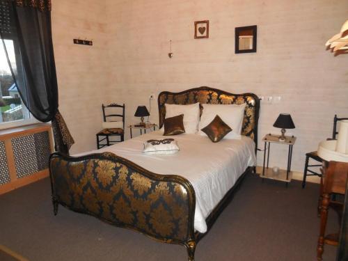 Un ou plusieurs lits dans un hébergement de l'établissement L'Âme du Gourmand