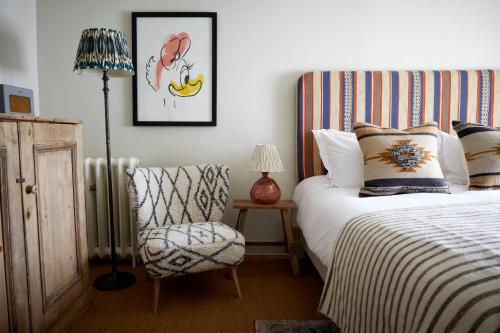 A bed or beds in a room at Artist Residence Cornwall