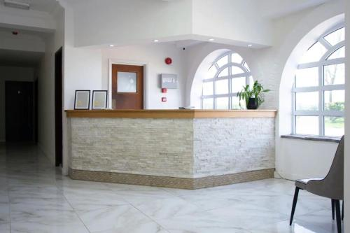 The lobby or reception area at Belvoir Hotel