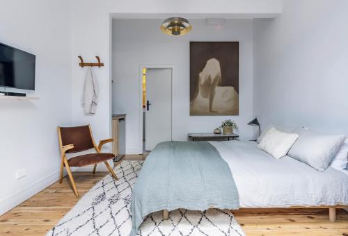 A bed or beds in a room at Bondi Beach House