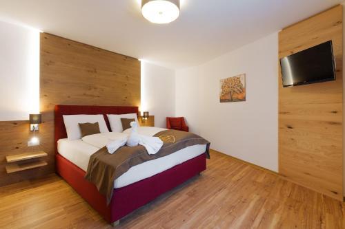 Кровать или кровати в номере Gasthof-Restaurant Kollar Göbl