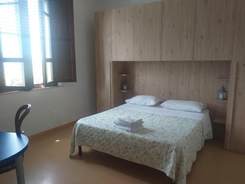 A bed or beds in a room at B&B Casa di Alfredo