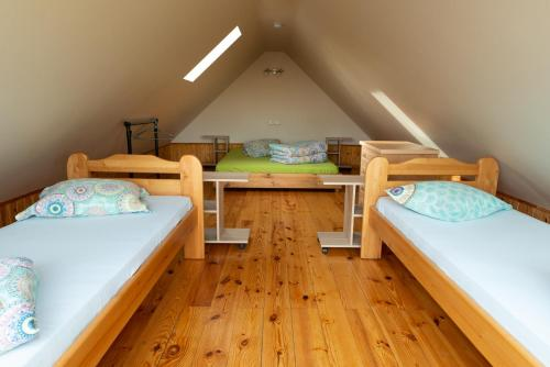 A bed or beds in a room at Ērgļi