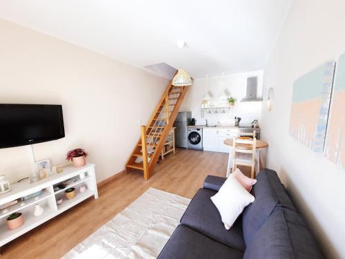 A seating area at Apartamentos Mar I Odeceixe