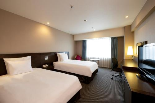 A bed or beds in a room at ANA Crowne Plaza Hiroshima, an IHG Hotel