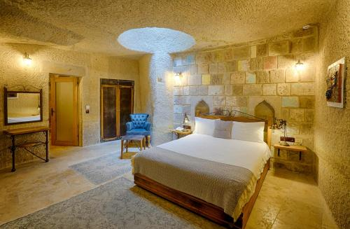 A bed or beds in a room at Design Cappadocia Hotel