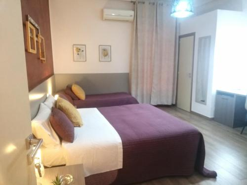 A bed or beds in a room at Bella Giulia