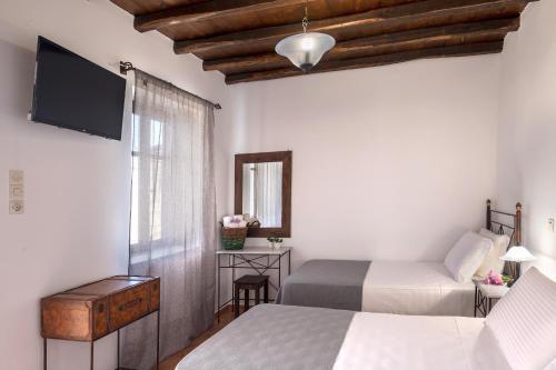 Ένα ή περισσότερα κρεβάτια σε δωμάτιο στο Cochili Rooms & Apartments