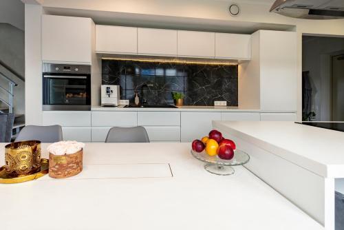 A kitchen or kitchenette at Luxury Villa