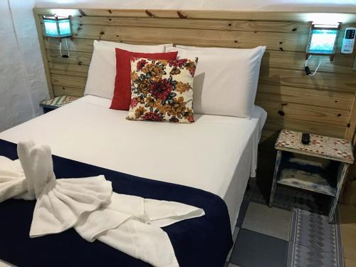 Cama ou camas em um quarto em Pousada Cacau