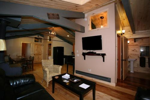 A television and/or entertainment centre at Lotus Mountain Suites - The Gallery