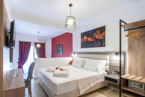 A bed or beds in a room at Hermes Apartments