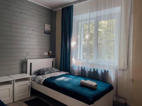 Кровать или кровати в номере Отель Пихтовый Бор