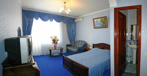 Кровать или кровати в номере Гостевой дом Morskoy Briz