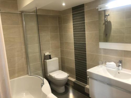 A bathroom at Tewin Bury Farm Hotel