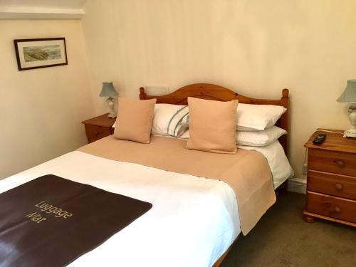 A bed or beds in a room at Rosalie Guest House