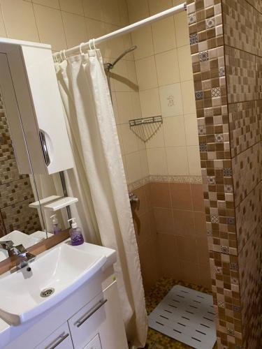 A bathroom at Гостевой Дом Визит