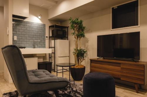 A television and/or entertainment centre at THREE