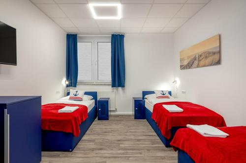 A bed or beds in a room at Koje Hostel