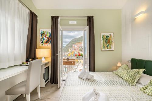 A bed or beds in a room at Casa Catò, Welcome Way