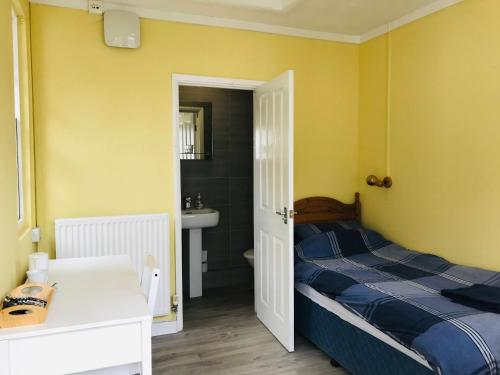 A bed or beds in a room at FSC Orielton Hostel