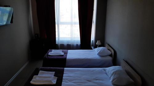 Кровать или кровати в номере Отель Бизнес Холл