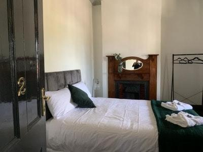 A bed or beds in a room at Belmore Hotel Scone