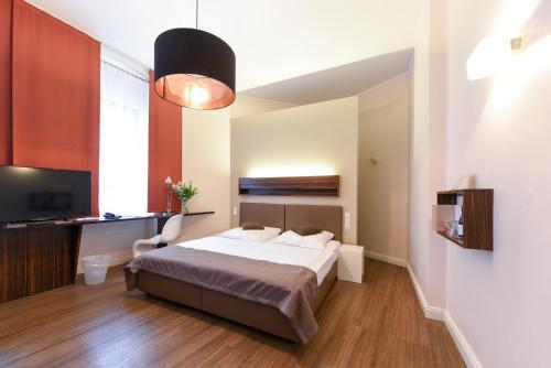 A bed or beds in a room at Hotel Casa Colonia