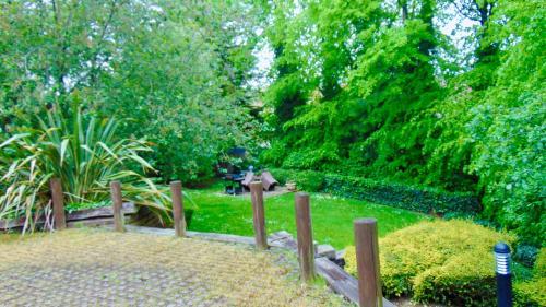 A garden outside EMERALD SUITES LIMITED (ESL10SC)