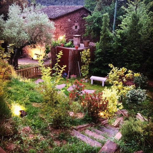 A garden outside Les Casetes del Congost Vilatge Resort Barcelona