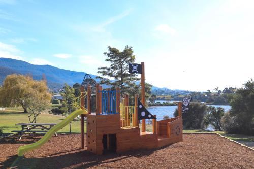 Children's play area at Riverfront Motel & Villas