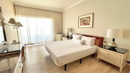 En eller flere senger på et rom på Rodos Palace Hotel