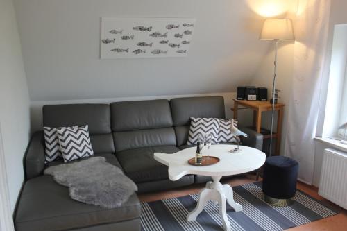 Ein Sitzbereich in der Unterkunft Apartments Domicil Alice