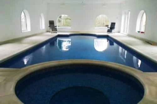 The swimming pool at or near Country Manor House with Indoor Pool and Jacuzzi