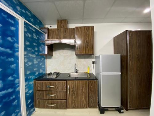 A kitchen or kitchenette at • Faizi Furnished Apartments