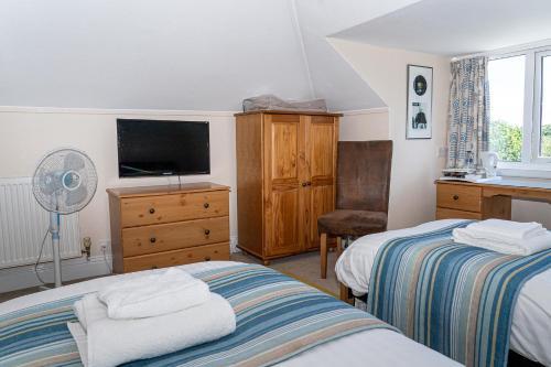 Кровать или кровати в номере Stour Lodge Guest House