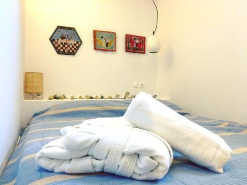A bed or beds in a room at Blé - Traditional Renovated Cottage