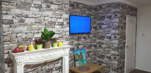 A television and/or entertainment center at Best Stay - Stoke on Trent