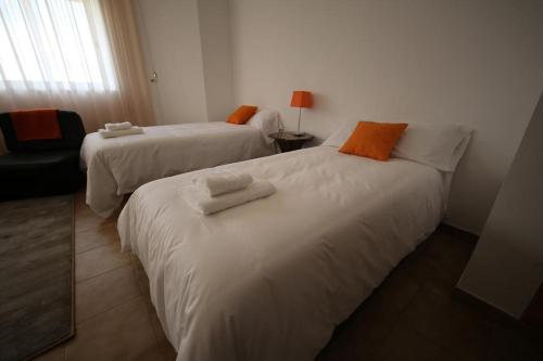 A bed or beds in a room at HOTEL NOVO