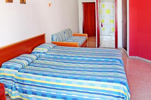 A bed or beds in a room at Hotel Sol de Mallorca