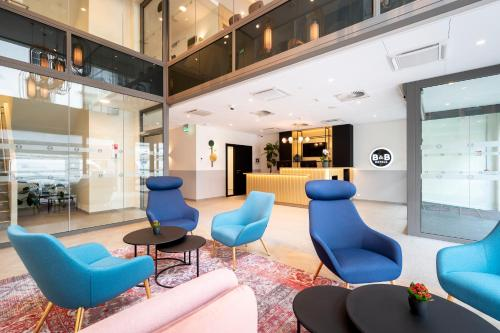 The lobby or reception area at B&B Hotel Gent Centrum