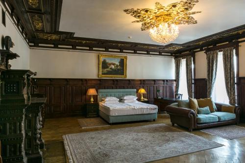 A bed or beds in a room at Rossi Boutique Hotel