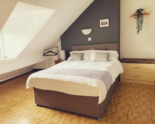 A bed or beds in a room at YALLY hotel
