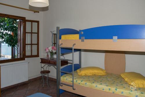 Μία ή περισσότερες κουκέτες σε δωμάτιο στο Pantheon Apartments
