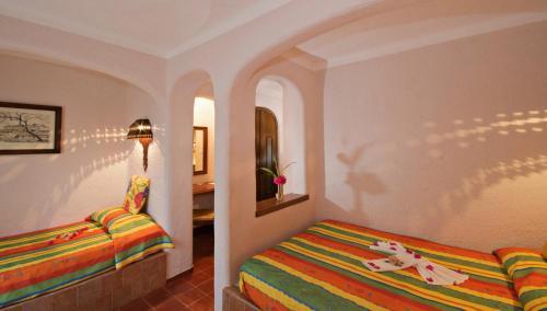 Cama o camas de una habitación en Villas Arqueologicas Chichen Itza