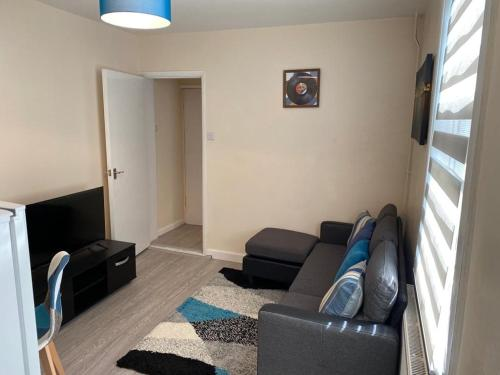 A seating area at Excellent and Amazing Apartment with Private Parking