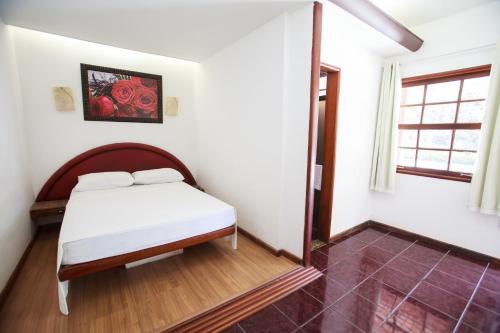 Cama ou camas em um quarto em Guarapousada
