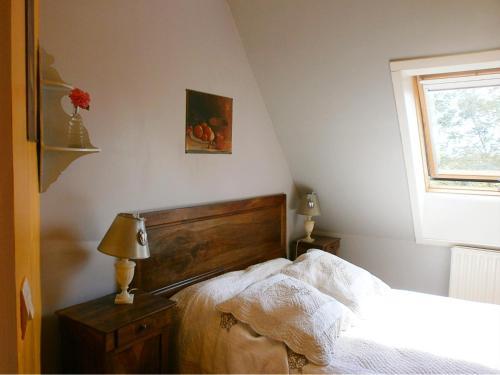 Un ou plusieurs lits dans un hébergement de l'établissement Loge & Broc